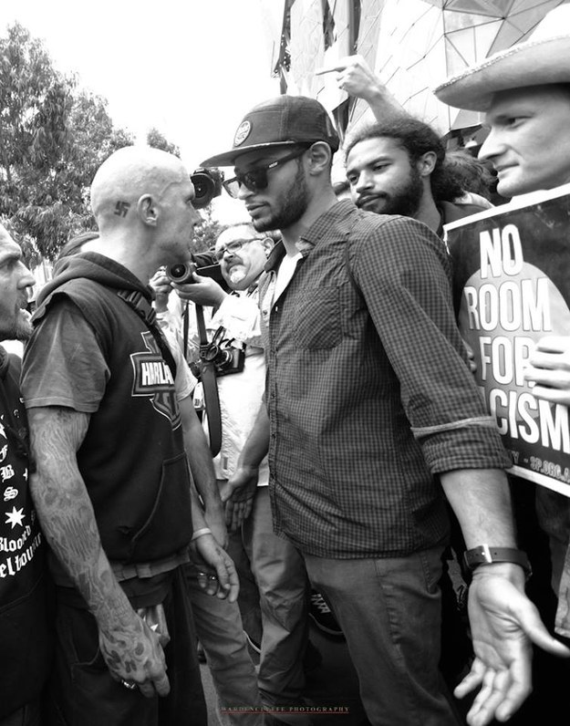 A counter-protestor calmly stands in the way of a man with a swastika tattoo at the Melbourne Reclaim rally - photo by Kenji Wardenclyffe
